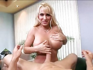 Blonde secretary with glasses and massive boobs does titjob in office