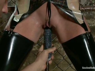 Felony receives bound to the fence and has a machine toy her til that babe cums