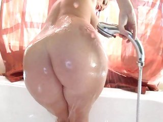 Chick Sophie Dee showers off after a hard work out