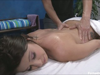 Black haired cutie Abby with juicy natural tits and lovely ass takes off her black bra and red panties to enjoy massage. She enjoys massage naked with her face down.