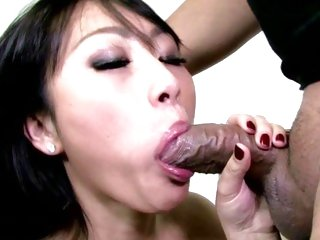 Evelyn Lin takes a hard dick down her slippery throat