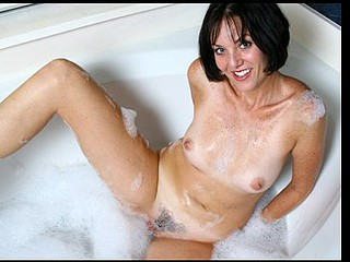 Darksome haired mother i'd like to fuck with tan lines bonks a fake penis in the bath tub
