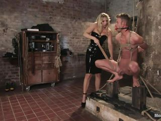 blonde mistress inducing pain to her sex slave