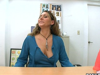 Curly haired brunette Devon James is doing blowjob to her boss