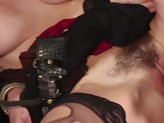 A blonde with some nice tits receives three cocks at the same time