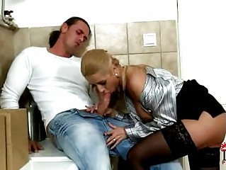 Turned on blonde pornstar in shirt gives blowjob in toilet
