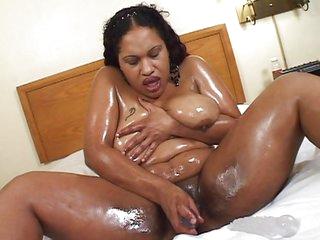 Bulky ebonies receive oiled