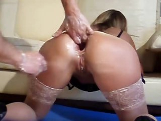Double fisting her ass while this babe wears stockings