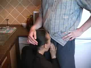 Horny milf in business clothes boned in kitchen